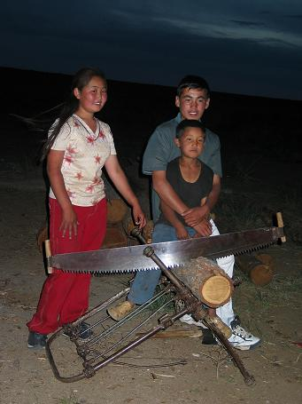 Kids making fire wood in the night
